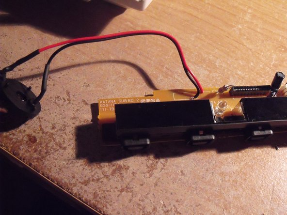 Solder the replacement battery holder to two electrical wires.