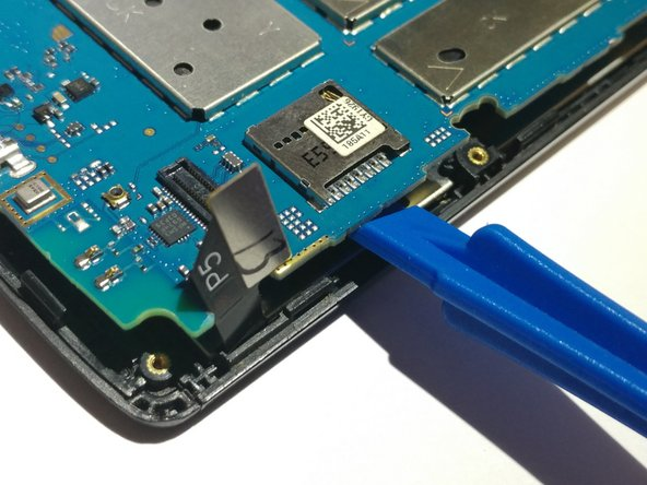 On the side with the screen connector, pull the two tabs away from the device.
