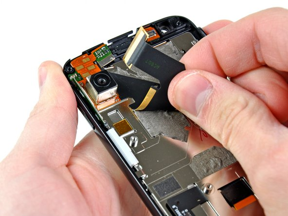 We can also remove the rear camera assembly and its cable.