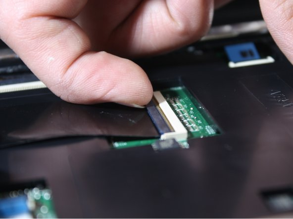 Flip up the black flap where the keyboard cable connects to the motherboard