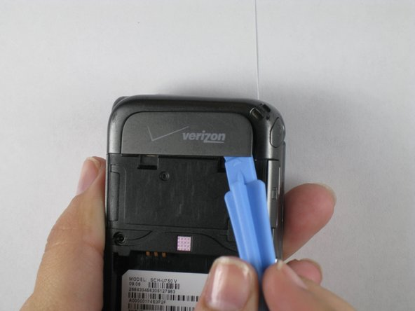 Use plastic opening tools to peel off plastic Verizon logo tab from the top of the back outside.