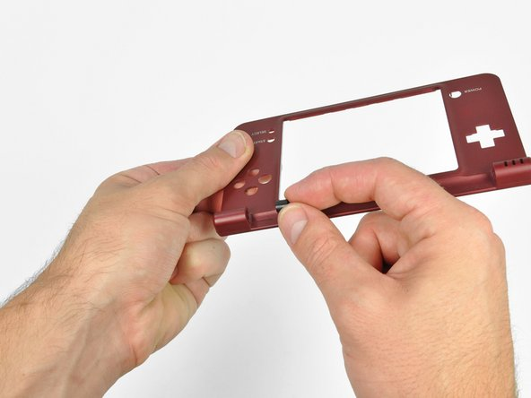Remove the hollow hinge pin from the right side of the DSi XL.