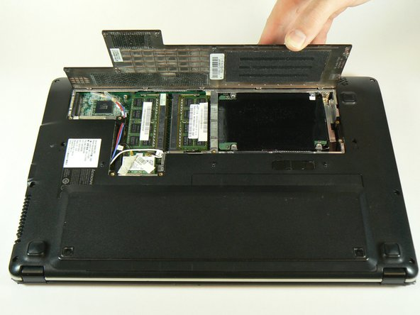 Lift the back panel from the side closest to the battery and remove the panel.