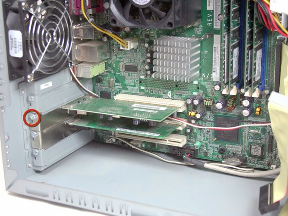 Remove the Torx T15 screwdriver holding the PCI card in place.