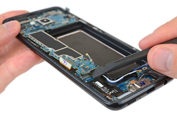 The I/O board connector is under the motherboard in these late-model Galaxy phones. Because why not make things harder?