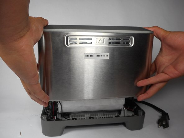 Remove toaster's outer shell by lifting straight up.