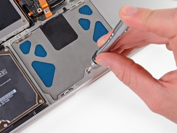 Before tightening, make sure that the trackpad is freely moving up and down. If you feel stiffness, try to very gently adjust it so that in its untightened position the lower part easily moves up and down.