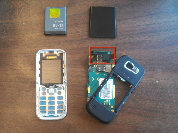 """The antenna is the """"L"""" shaped device located on the top of the phone in between the back case and the board."""