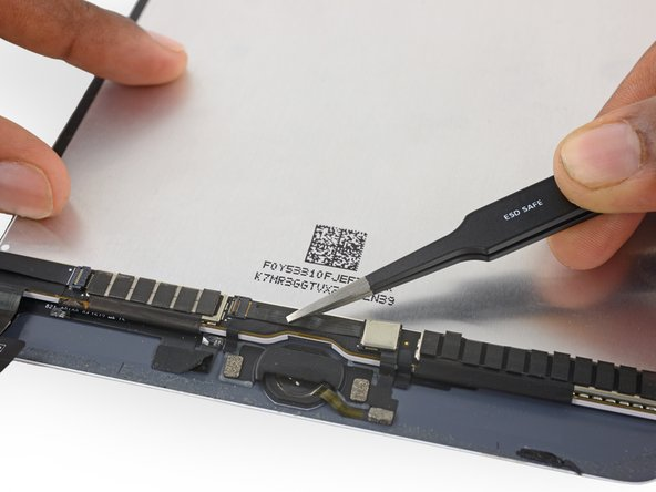 Use tweezers to unplug the home button ribbon cable from the ZIF socket.