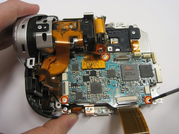Remove (3) 2.9mm screws from top circuit board.