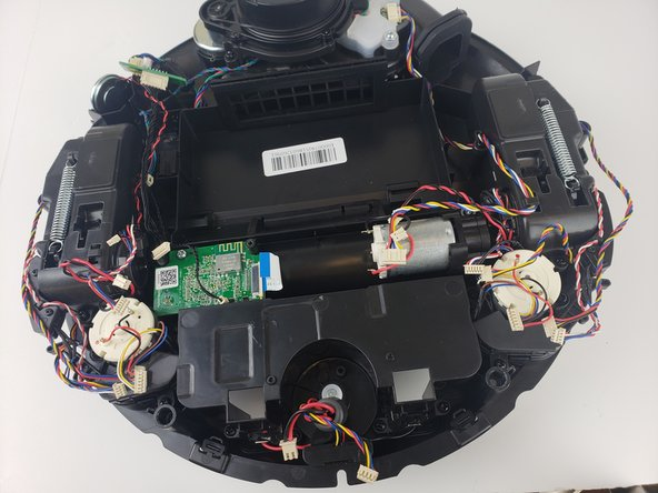 Lift the motherboard out of the Deebot and remove it from the device.