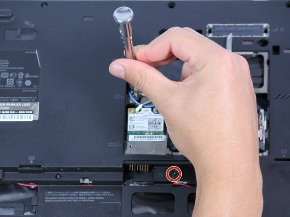 Remove the two 5mm screw using the Phillips #0 screwdriver.