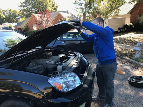 Gently lower the hood until it clicks into the secondary latch.