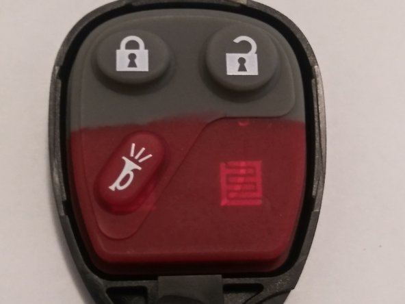 "To remove the buttons, lift the ""rubber button pad'' from the key fob shell."