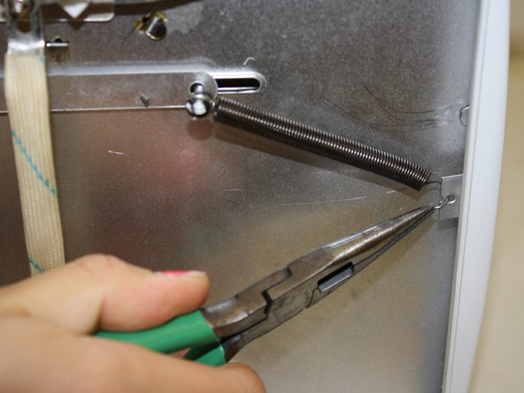 Use pliers to bend the spring back into place if necessary.