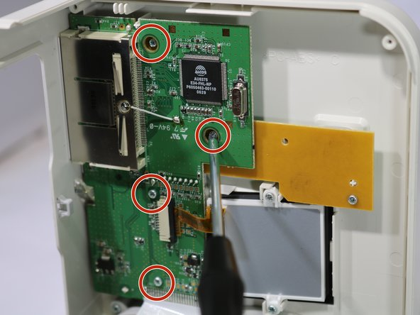 Remove the four 8mm Phillips #00 screws that hold the upper circuit board to the shell.