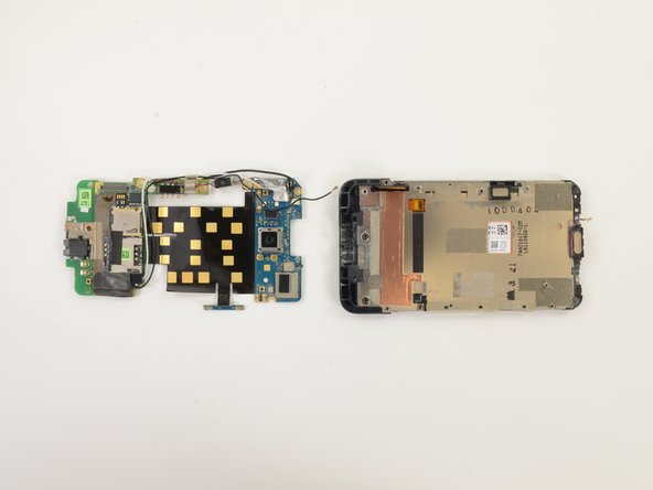 Once the adhesive-laden logic boards are separated from the mid chassis, the entire assembly easily comes off.