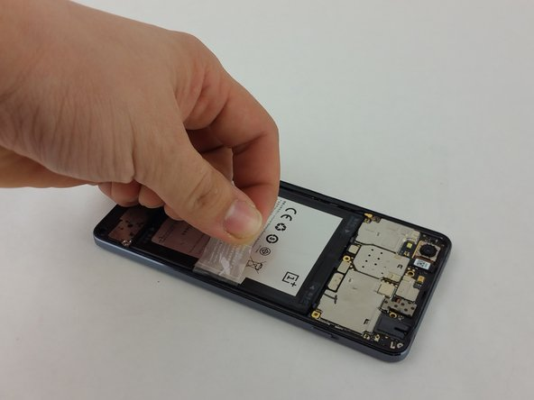 On the battery, locate a clear tab. This will be used to pull the battery out.