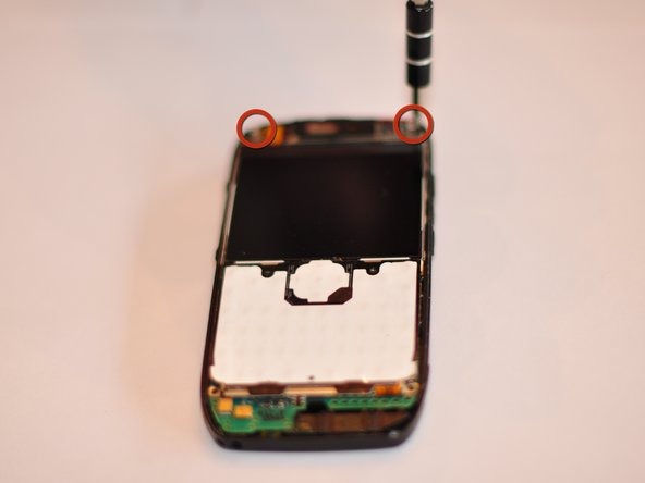 Using Torx number 4 unscrew the two 0.7 mm screws at the top of the device.