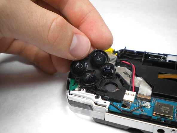 After removing the LCD Screen, the Button Pad should be easy to remove.