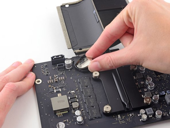 Lift and remove the PRAM battery off the logic board.