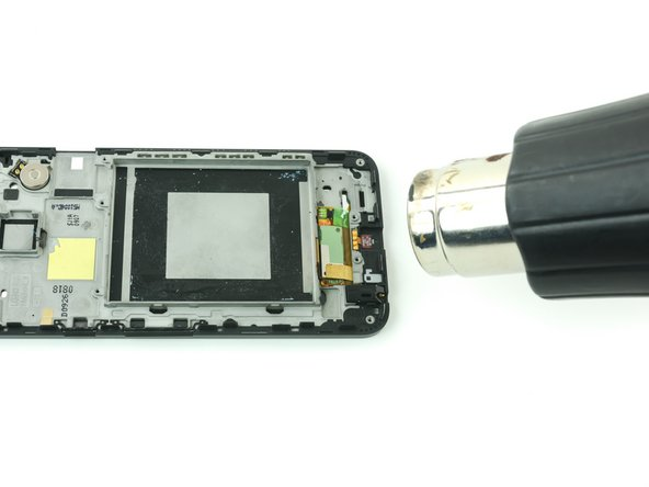 Use an iOpener or a heat gun over the digitizer ribbon cable to soften the adhesive that secures it to the plastic housing.
