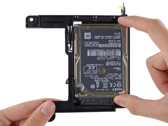 Lift the hard drive up and remove it from the drive tray.