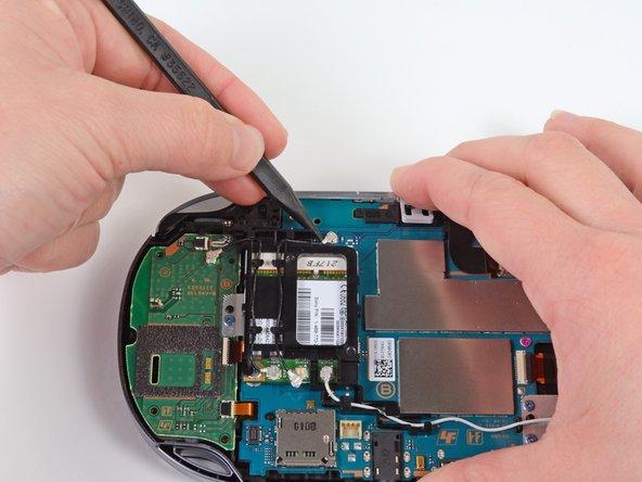 Using the pointy end of a spudger, gently pry the GPS antenna cable off of the motherboard.