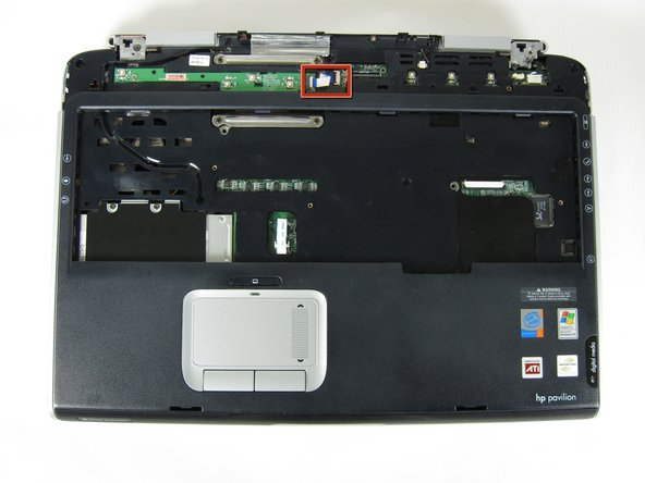 Find the ribbon cable on the LED board located at the top of the laptop.
