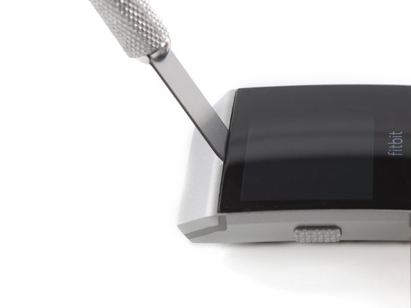 Use a technician's razor with a flat blade to pry up the top edge of the display and create a small gap.