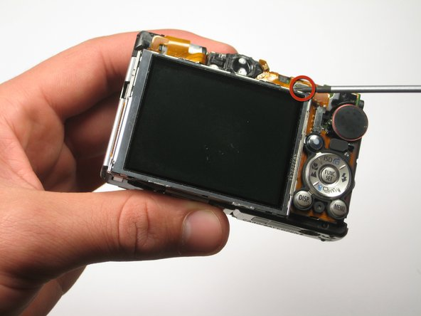 Remove the screw at the upper right-hand corner of the LCD screen