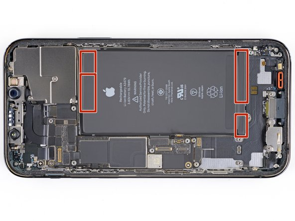 The battery is secured to the rear case with four pieces of stretch-release adhesive—two on the bottom edge of the battery, and two on the top edge.