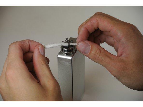 Take cotton strand and thread through one coil.