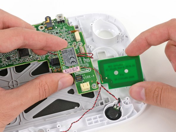The Wii U loses its ability to communicate with near fields as we remove the NFC module and antenna.
