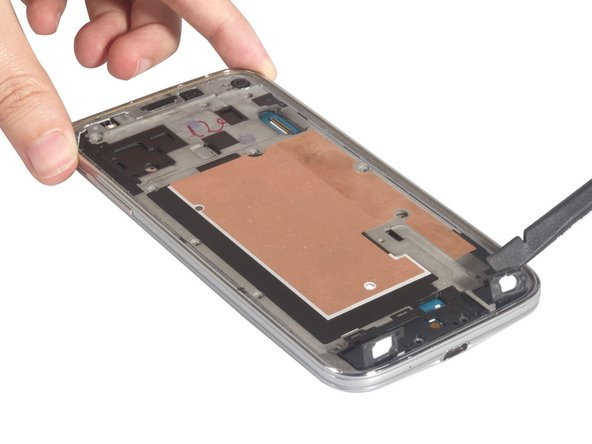 Get loosen the touch keys from adhesive, and then push the mid-plate out from the middle housing.