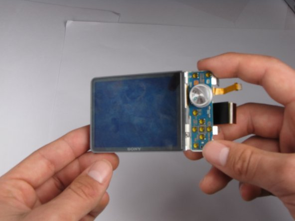 Rotate the LCD and its casing so that the screen is facing you.