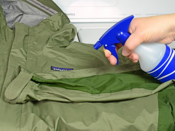 Lay your jacket on a table or flat surface.