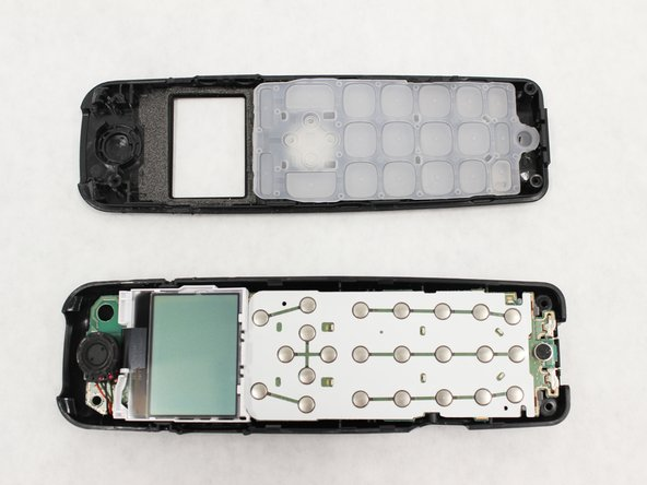 With the screw removed, the front panel assembly can be separated from the rest of the device.
