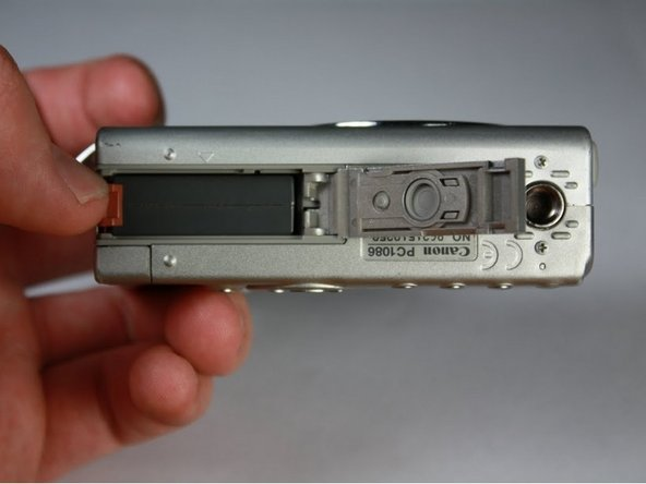 Rotate the camera so that the slot is horizontal.