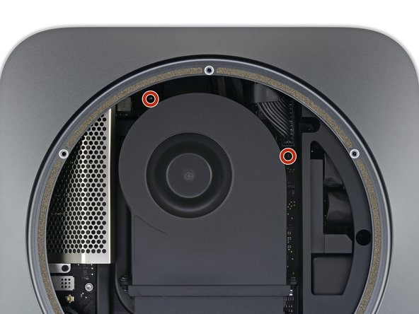 Use a T6 Torx driver to remove the four 7.2 mm screws securing the fan: