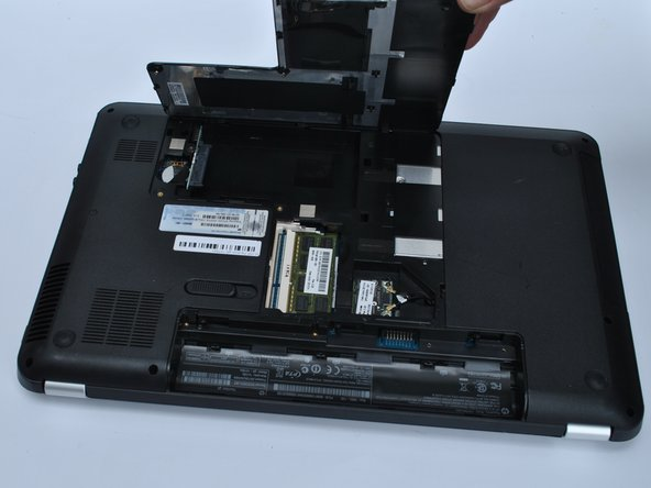 Unsnap the Cover by lifting the edge along the battery compartment.
