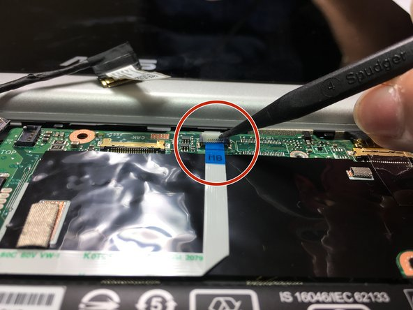 Disconnect the motherboard to powerboard cable from the motherboard using the pointed end of a plastic spudger.