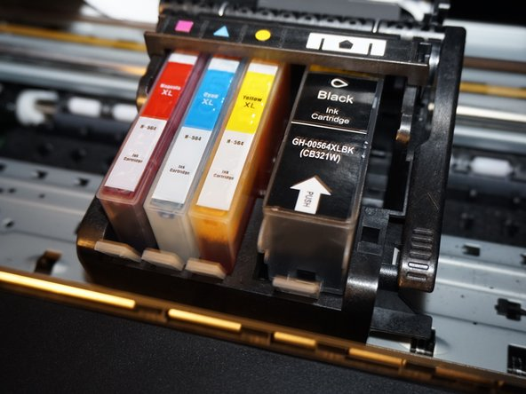 Remove the ink cartridges from the printer. Install the shipping caps or put them in a plastic bag.