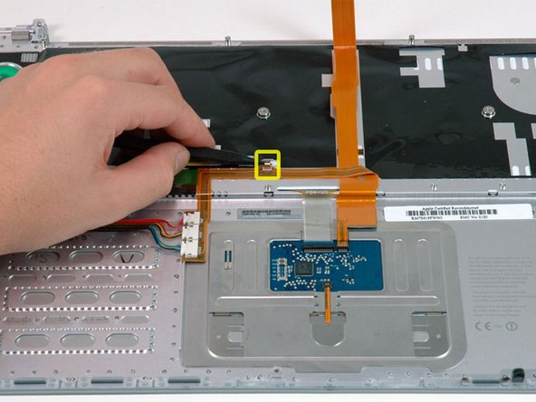 Use a spudger or your finger to slide the keyboard backlight ribbon out of its connector.