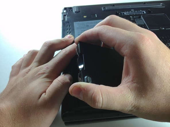 Using your hand, lift up the battery.