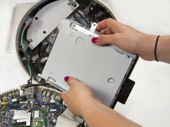 Grasp the HD/Optical Drive bundle by the by the sides and gently wiggle it loose from the sides.