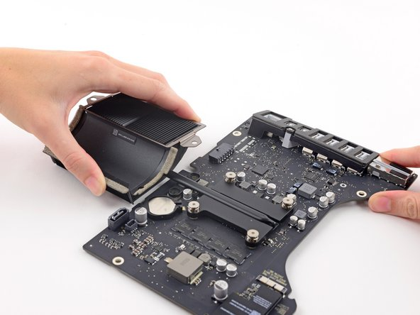 Slowly lift and remove the heat sink from the logic board.