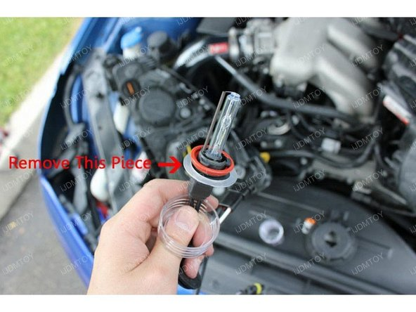 Take out the HID bulb from the plastic shell and remove the circular plastic piece.