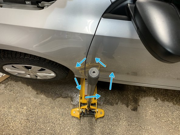 Lower the individual car side onto the ground by turning the handle of the car jack counter-clockwise