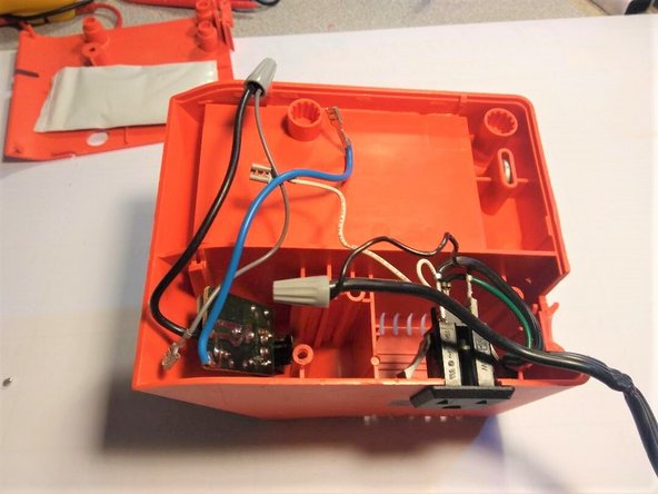 Separate the bottom and top half of the soldering station.